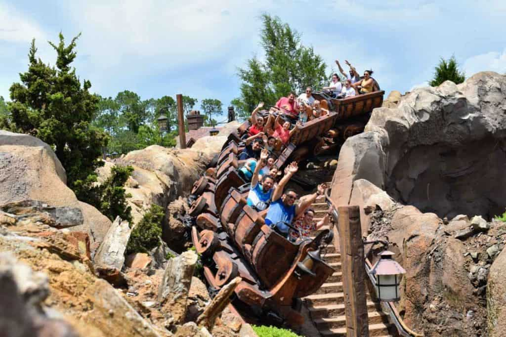 Guests riding Seven Dwarfs Mine Train.