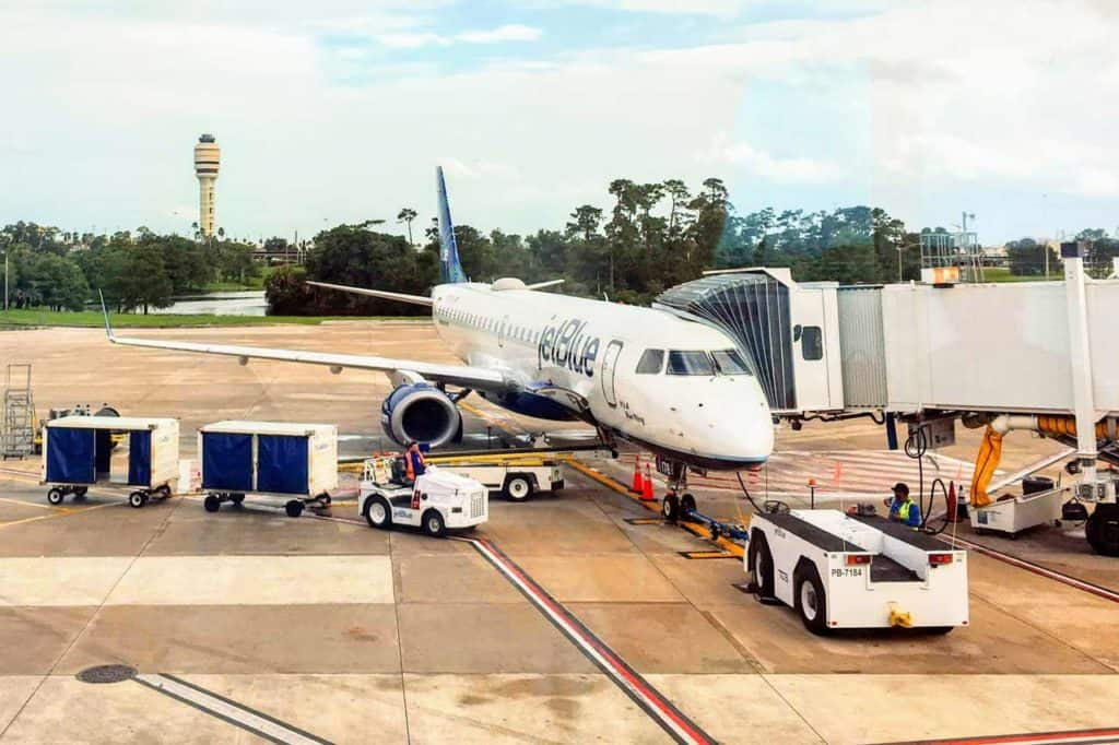 Take Disney's Magical Express from Orlando International Airport.